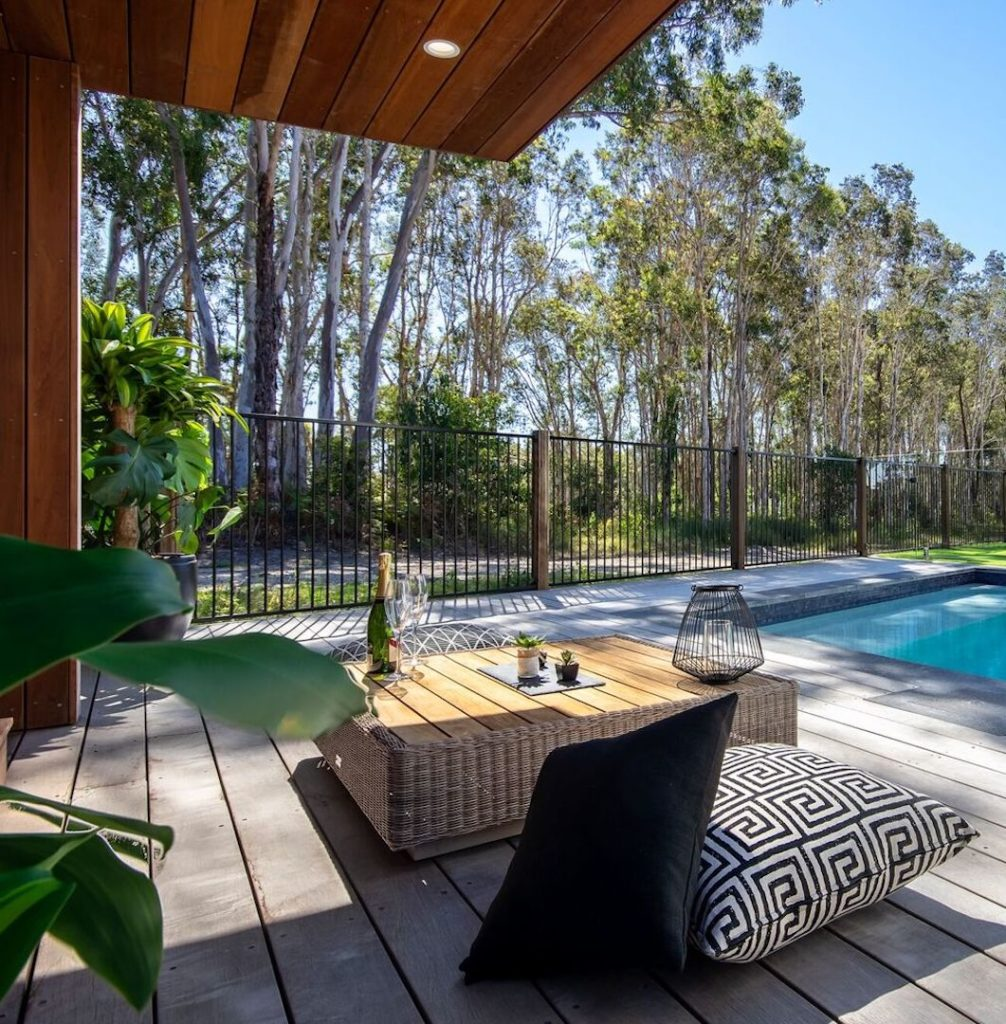 Sunshine Living Builders create outdoor living spaces that flow in and out of the interior rooms